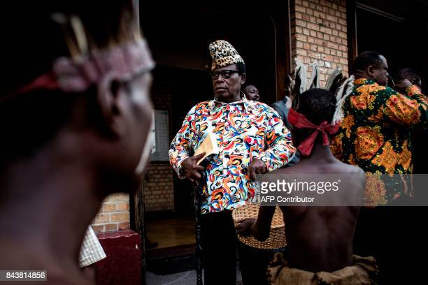 TOPSHOT Relatives of Mobutu Sese Seko late dictator of Zaire former name of Democratic Republic of the Congo attend a mass marking the 20th...