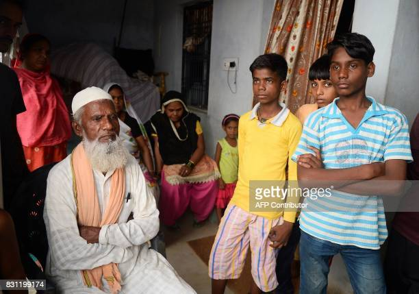 Relatives of Mohammad Zahid who lost his fiveandahalf year old daughter Khushi mourn in Gorakhpur in the Indian state of Uttar Pradesh on August 14...