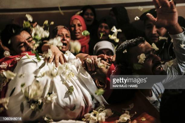 TOPSHOT Relatives of Mohammed Ouda killed in an Israeli air stike the previous day mourn during his funeral in Beit Lahia in the northern Gaza Strip...