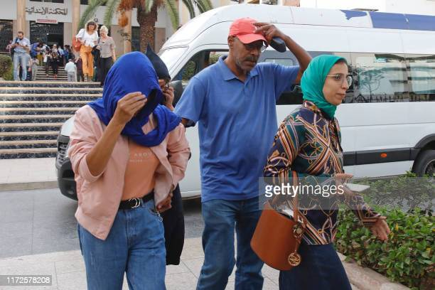 Relatives of Moroccan journalist Hajar Raissouni leave the court following her sentencing for alleged sexual relations outside marriage and an...