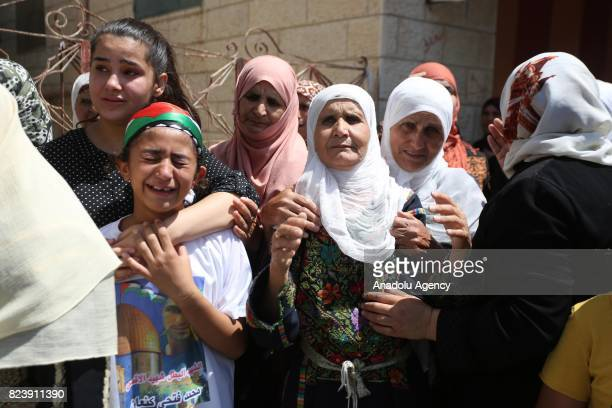Relatives of Muhammad Fathi Kanaan who was killed by Israeli security forces during a demonstration against Israeli restrictions on Al Aqsa mourn...