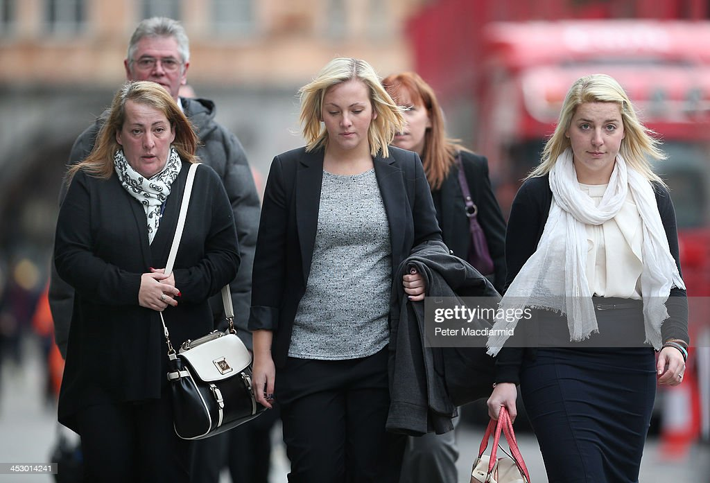 Relatives of murdered fusilier Lee Rigby (L-R) Stepfather Ian Rigby, mother Lyn Rigby, sister Sara McLure and fiancee Aimee West arrive at the Old Bailey on December 2, 2013 in London, England. Michael Adebolajo and Michael Adebowale are charged with murdering Fusilier Lee Rigby as he walked back to Woolwich Barracks in south-east London on May 22, 2013.