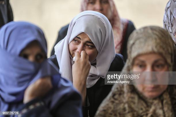 Relatives of Nasir Ahmed Garrab who lost his life after Israeli soldiers opened fire on protest held to mark 70th anniversary of Nakba also known as...