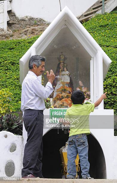 Relatives of one of the miners trapped inside Casa Negra mine in Portovelo Ecuador pray at the mine on October 18 2010 Rescuers sought for a fourth...