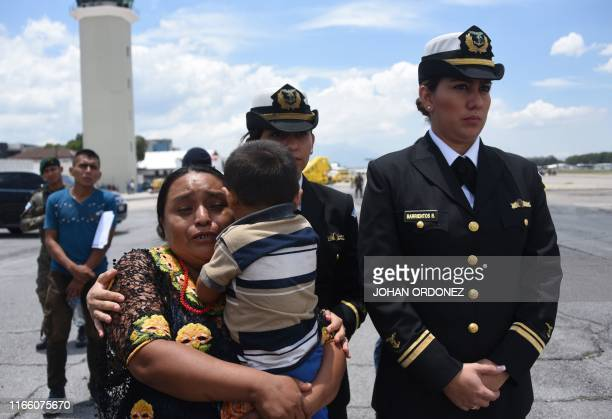 Relatives of one of the tree soldiers killed in El Estor municipality, Izabal department, react upon the arrival of their coffins at the Air Force...