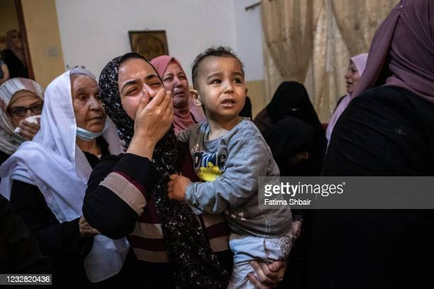 Relatives of Palestinian Ahmed Al-Shenbari, who was killed during an Israeli raid in Beit Hanoun city on the northern Gaza Strip, mourn during his...