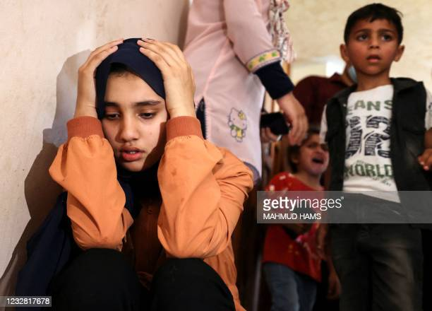 Relatives of Palestinian Hussien Hamad mourn during his funeral in Beit Hanoun in the northern Gaza Strip on May 11, 2021. - Israel and Hamas...