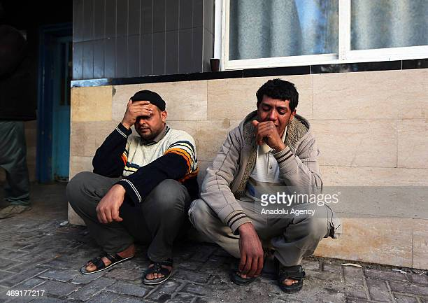 Relatives of Palestinian Ibrahim Mansour shot dead in the head by Israeli forces mourn outside a local hospital in Gaza City on February 13 2014 A...