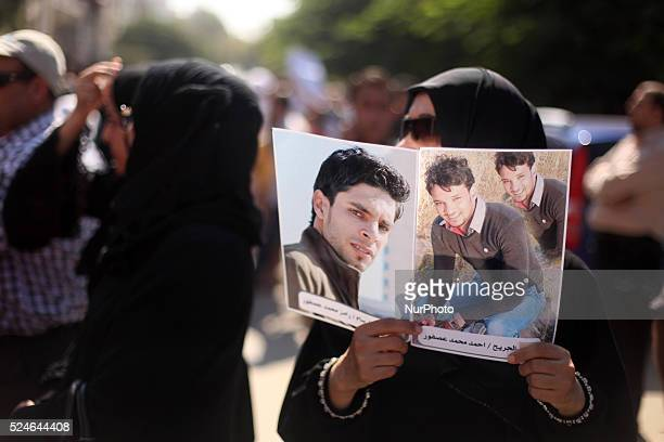 Relatives of Palestinian immigrants on a ship of Alexandria and drowned in the sea during a protest in front of the Red Cross office in Gaza City to...