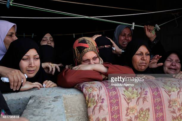 Relatives of Palestinian Marwan Sleem during his funeral in the central Gaza Strip July 7 2014 Israeli airstrikes aiming Gaza leave 9 death from...