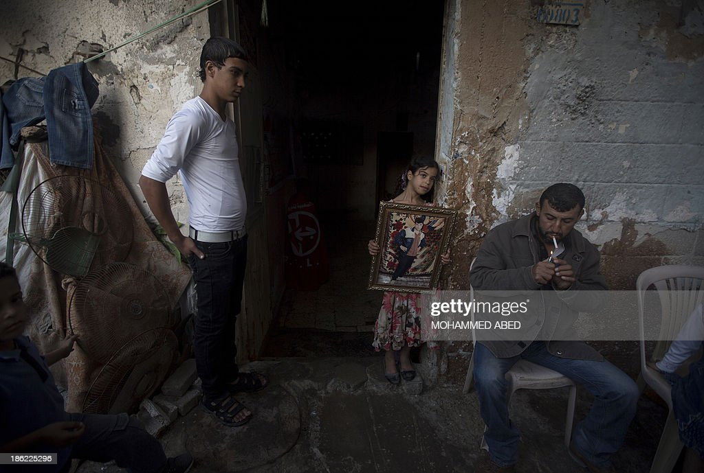 Relatives of Palestinian prisoner Omar Massud, held by Israel since 1993, wait for his release at their family house in Gaza City on October 29, 2013