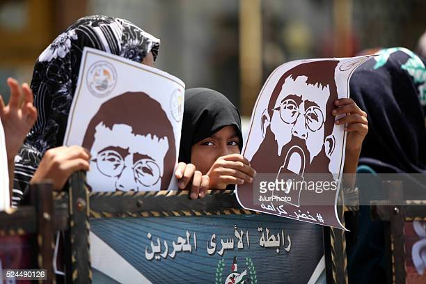 Relatives of palestinian prisoners stage a rally in Gaza on June 28, 2015. A human chain in solidarity with prisoner Khader Adnan on hunger strike...