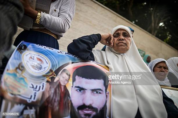 Relatives of Palestinians imprisoned in Israeli jails hold banners and flags during a demonstration demanding the release of Israeliheld Palestinian...
