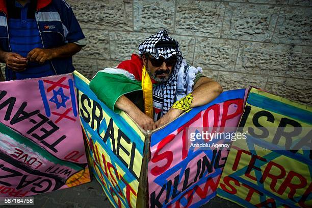 Relatives of Palestinians imprisoned in Israeli jails stage a demonstration demanding the release of Israeliheld Palestinian prisoners in front of...