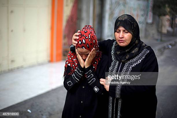 Relatives of Palestinians killed in an Israeli strike on a UN-run school, mourn in Beit Lahia, Gaza on July 30, 2014. The death toll from the Israeli...