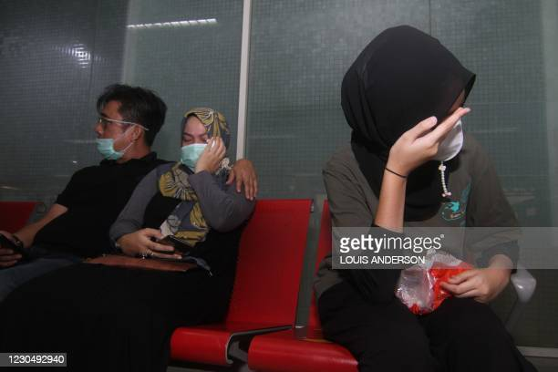 Relatives of passengers on board missing Sriwijaya Air flight SJY182 wait for news at the Supadio airport in Pontianak on Indonesia's Borneo island...