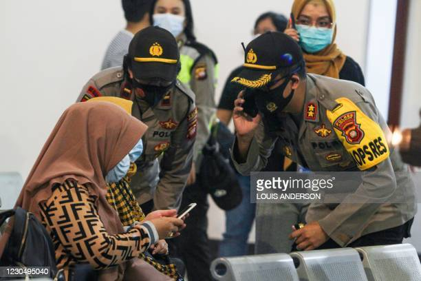 Relatives of passengers on board missing Sriwijaya Air flight SJY182 wait for news at the Supadio airport in Pontianak on January 9 after contact...