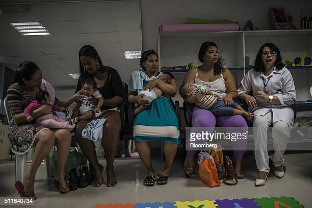 Relatives of patients suffering from microcephaly gather at the Altino Ventura Foundation in Recife Brazil on Thursday Feb 18 2016 The mosquitoborne...