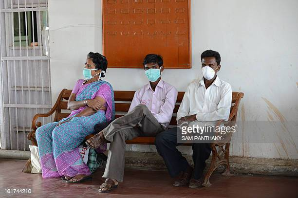 Relatives of patients with Swine Flu wait outside an an isolation ward at the Ahmedabad Civil Hospital in Ahmedabad on February 15 2013 In a span of...