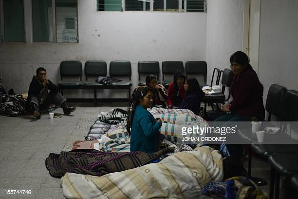 Relatives of people injured in an earthquake spend the night at a hospital in San Marcos on November 7 2012 At least 48 people died in southwestern...