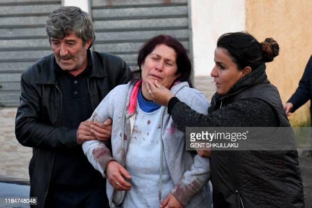 Relatives of people living at a collapsed building cry in Thumane 34 kilometres northwest of capital Tirana after an earthquake hit Albania on...