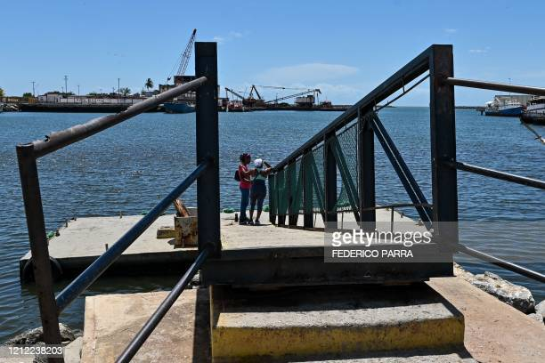 Relatives of people who disappeared in two shipwrecks en route from Venezuela to Trinidad and Tobago on April 23 and May 16 are seen in the port of...