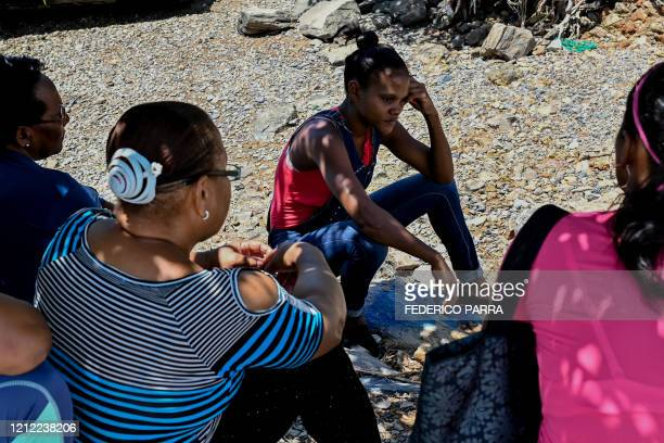 Relatives of people who disappeared in two shipwrecks en route from Venezuela to Trinidad and Tobago on April 23 and May 16 talk during a meeting in...