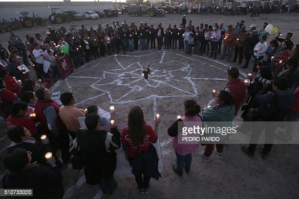 Relatives of people who disappeared protest near the airport of Ciudad Juarez Mexico on the eve of the arrival of Pope Francis on February 16 2016...