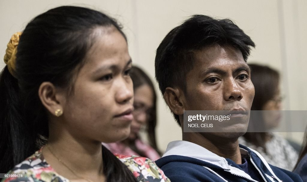 Relatives of Philippine overseas worker Joanna Demafelis, whose body was found inside a freezer in Kuwait, attend a hearing on migrant workers at the Senate building in Manila on February 21, 2018. Philippine officials are headed to Kuwait February 22 to seek greater protection for migrant workers, after a diplomatic row over the alleged mistreatment of Filipinos in the Gulf state. Labour Secretary Silvestre Bello told reporters February 21 one of his deputies would lead the delegation, which is also due to stop in Saudia Arabia and Qatar to urge reforms. /