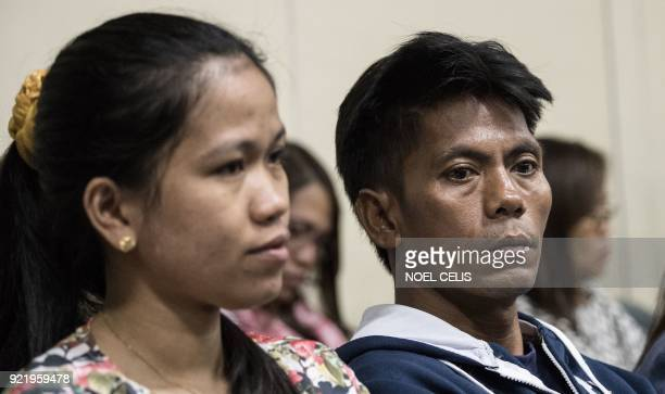 Relatives of Philippine overseas worker Joanna Demafelis whose body was found inside a freezer in Kuwait attend a hearing on migrant workers at the...