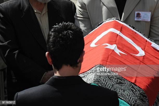 Relatives of Prince Osman Ertugrul pray by his coffin on September 26 2009 during the funeral ceremony at the Blue Mosque Istanbul Prince Osman...