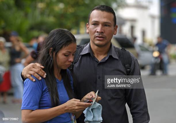 Relatives of prisoners wait outside a police holding cells that caught fire in Valencia northern Carabobo state Venezuela on March 29 2018 A total of...