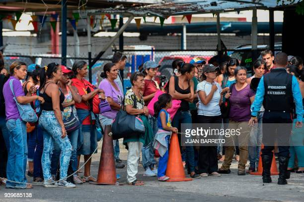 Relatives of prisoners wait outside the police headquarters in Valencia northern Carabobo state Venezuela on March 29 2018 A total of 68 people died...