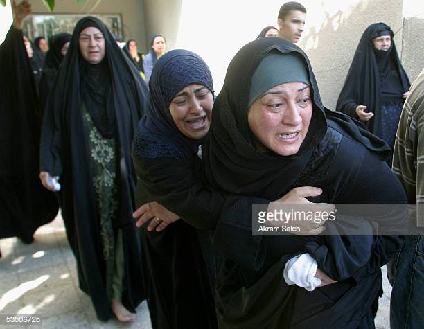 Relatives of Reuters TV soundman Waleed Khaled react during his funeral on August 29 2005 in Baghdad Iraq A Reuters television sound technician was...