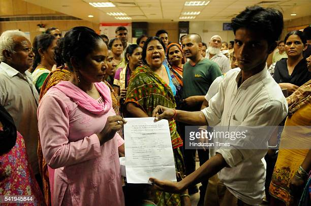 Relatives of Sangeeta Devi showing the document by Bhim Rao Ambedkar Multispeciality Hospital which mentions twins as they stage protest at...