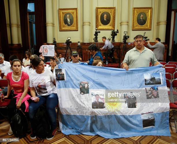 Relatives of Senior Corporal Alejandro Polo hold an Argentine flag that reads 'ARA San Juan we are expecting you' during a meeting held by the FPVPJ...