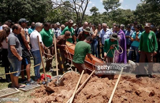 Relatives of Sidinei Vitor Monteiro one of the victims of mass shooting inside Campinas' Cathedral attend his funeral at Parque das Flores cemetery...