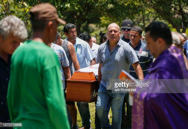 Relatives of Sidinei Vitor Monteiro one of the victims of mass shooting inside Campinas' Cathedral carry his coffin during his funeral at Parque das...