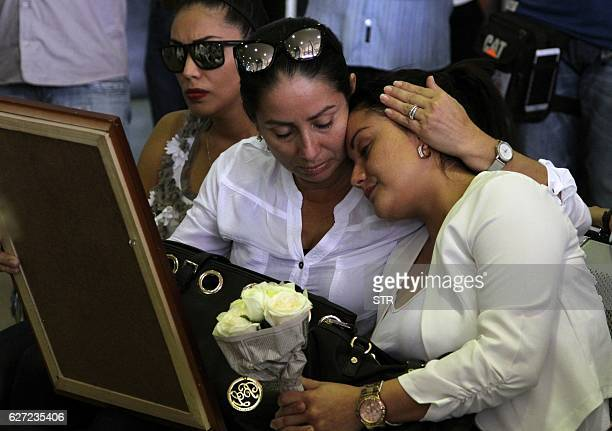 Relatives of Sisi Arias wait at the ViruViru airport in Santa Cruz Bolivia on December 2 2016 for the arrival of the coffins from Medellin Colombia...