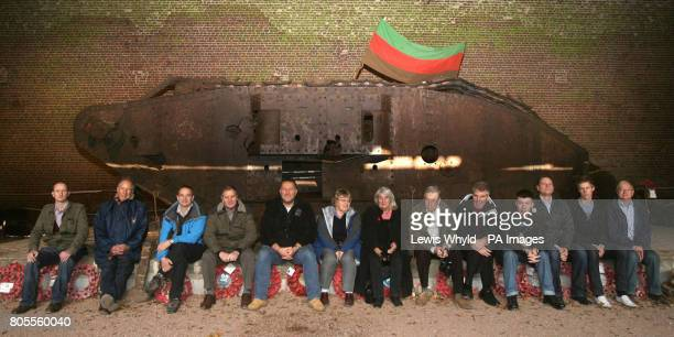 Relatives of soldiers who fought in 'Deborah' a mark IV D51 tank sit in front of the excavated remains in Flesquieres France near to where it was...