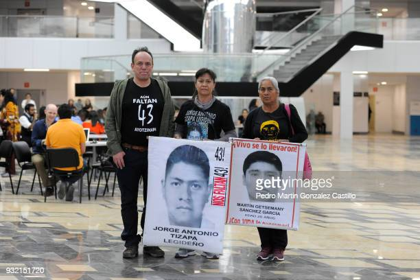 Relatives of some of the 43 disappeared in Ayotzinapa display banners at Conjunto de Artes Escénicas as part of 33 Guadalajara International Film...
