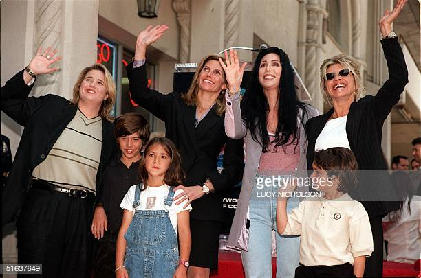 Relatives of Sonny Bono daughter Chastity son Chesare and daughter Chianna widow Mary Bono exwife Cher daughter Christy with her son Nico pose after...