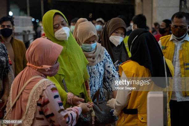 Relatives of Sriwijaya Air flight SJ 182 arrive at the crisis centre in Soekarno Hatta Airport, on January 09, 2021 in Jakarta, Indonesia. Sriwijaya...