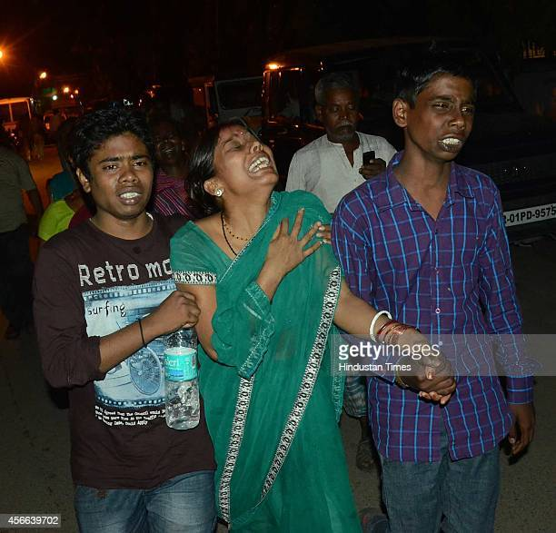 Relatives of stampede victims during the Dussehra celebration at Gandhi Maidan on October 3 2014 in Patna India At least 33 people have been...