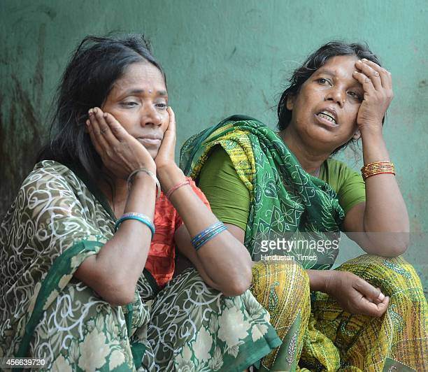 Relatives of stampede victims during the Dussehra celebration at Gandhi Maidan on October 4 2014 in Patna India At least 33 people have been...