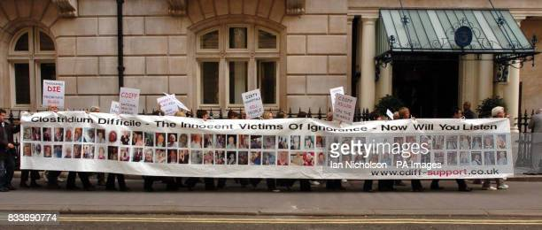 Relatives of sufferers of Clostridium Difficile a bacterial infection of the gut unveil a banner showing 80 victims of the disease following a march...
