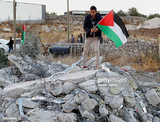 Relatives of the 15year old Palestinian teenager Murad Ideis who was arrested on stabbing to death an Israeli settler in Otniel inspect the debris of...