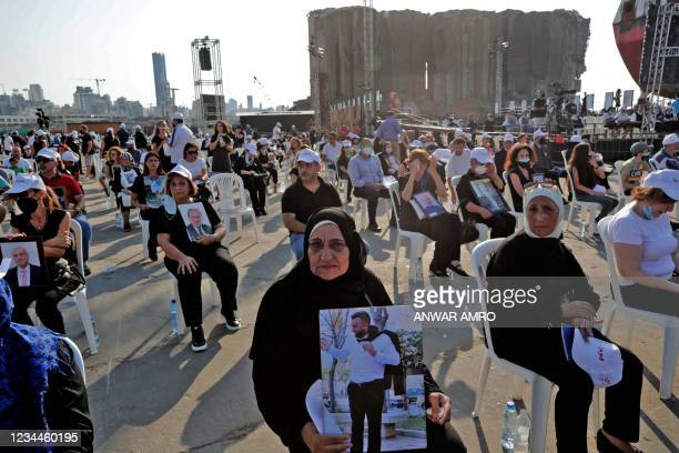 Relatives of the 2020 Beirut blast victims attend a Maronite Christian mass at the port of Lebanon's capital Beirut on August 4 on the first...