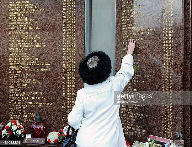 Relatives of the 96 pay their respects at the Hillsborough memorial before it is taken into storage to allow for stadium redevelopment work at...