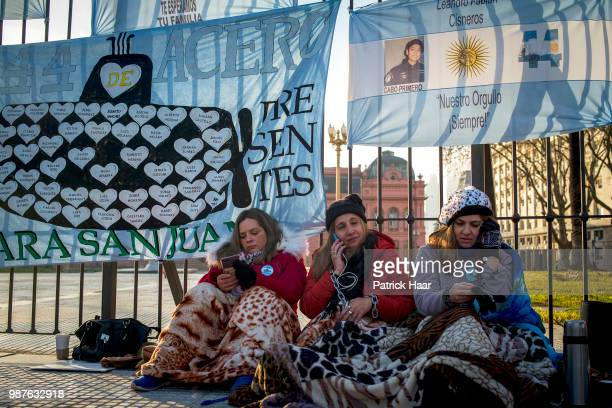 Relatives of the ARA San Juan crew with hands chained look on during a protest in front of the Casa Rosada demanding the government to continue the...